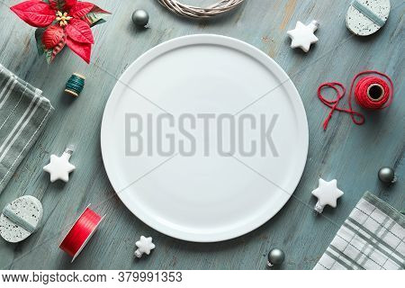 Christmas Background In Grey, Red And White Plate On Table. Geometric Flat Lay With Xmas Decorations