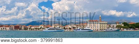 Panorama Of Split City Harbor With Sea, Passenger Ships, Historic Houses, Tower With Mountains.