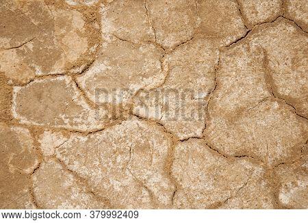 Arid Soils Under The Scorching Sun. World Drought.
