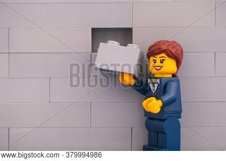 Tambov, Russian Federation - June 07, 2020 Lego Businesswoman Minifigure With Brick Ready To Finishi