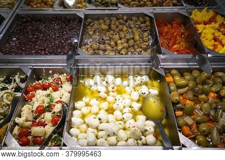 Variety Of Colorful Fresh Olive And Vegetable Salad In Restaurant