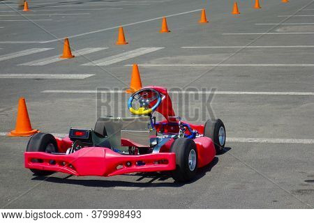 Small Colorful Racing Go Kart On The Race Track, Waiting For The Race To Start.