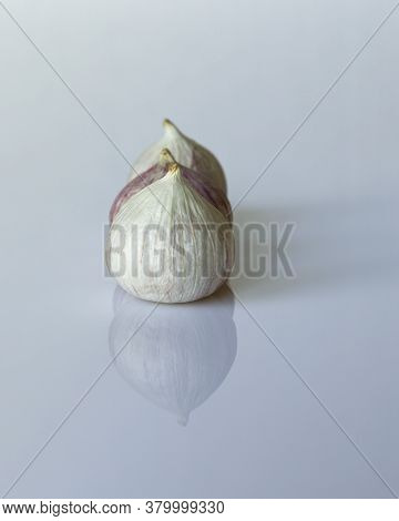 Fresh Solo Garlic Bulbs Which Are Used For Cooking On A White Background. They Are Grown In Asia