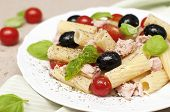 Fresh salad with pasta cherry tomatoes black olives tuna and basil poster