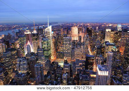 New York City Manhattan Times Square night city skyline aerial view with urban skyscraper illuminated. poster