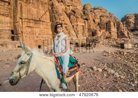 tourist riding donkey in nabatean petra jordan middle east