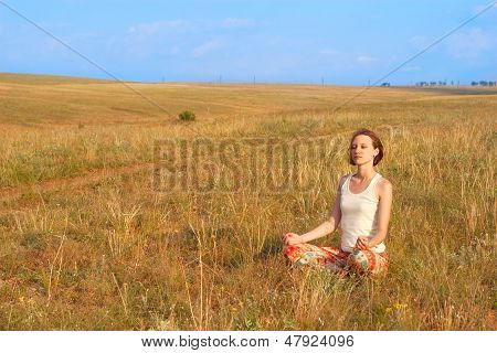 Slender Woman Meditate Outdoors