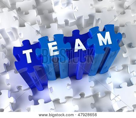 Creative 3D pieces of puzzle and word TEAM