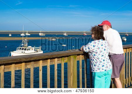 A Woman And Man Watch Boats