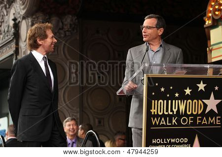 LOS ANGELES - JUN 23:  Jerry Bruckheimer & Robert Iger arrives to the Walk of Fame Honors Jerry Bruckheimer  on June 23, 2013 in Hollywood, CA