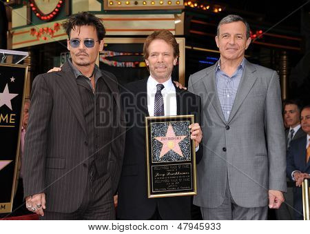 LOS ANGELES - JUN 23:  Johnny Depp, Jerry Bruckheimer & Robert Iger arrives to the Walk of Fame Honors Jerry Bruckheimer  on June 23, 2013 in Hollywood, CA