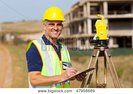 happy senior land surveyor at work