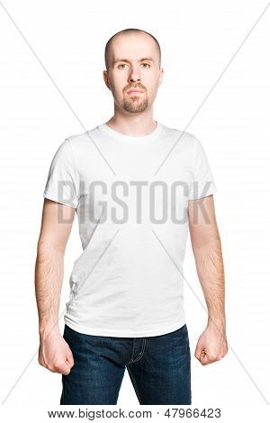 Handsome Man With Clenched Fists In White T-shirt And Blue Jeans Isolated On White