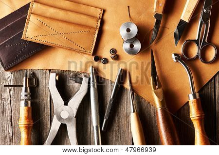 Leather crafting tools still life poster