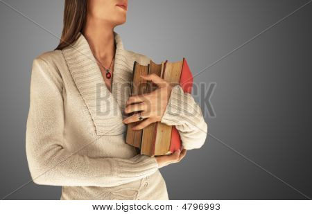 Woman Holding Large Books