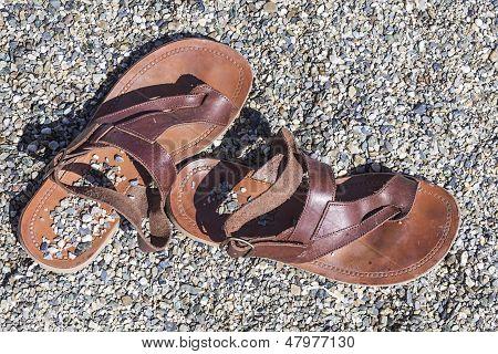 Sandals On A Rocky Beach