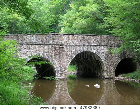 Fieldstone Bridge Over Summer Stream