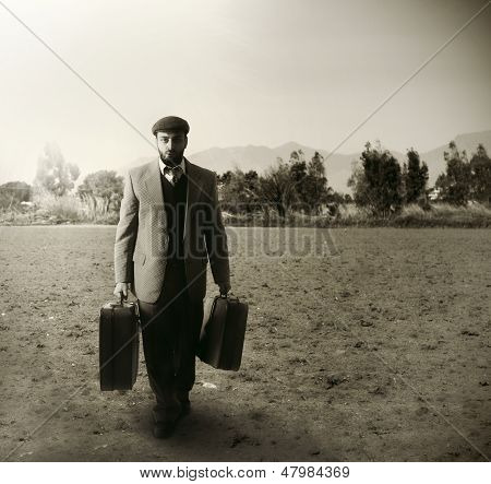 Immigrant With The Suitcases