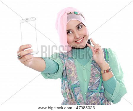 Happy Young Muslim Woman Take Self Portrait