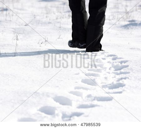 Person Walking In The Snow And Leaving Footprints