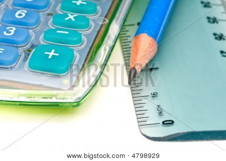 Blue Pencil With A Calulator And Ruler