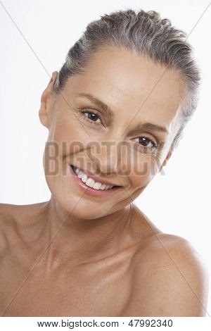 Closeup portrait of beautiful middle ages woman smiling on white background