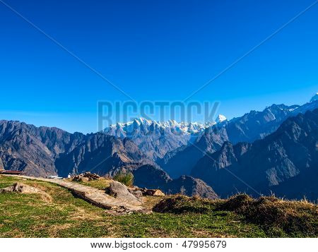 Sunrise in the Himalayas, the first rays of the sun -  view from Auli, India. poster