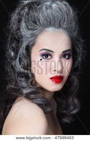 Portrait of young beautiful asian girl with vintage hairdo and stylish make-up