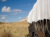 covered wagon on the oregon trail poster