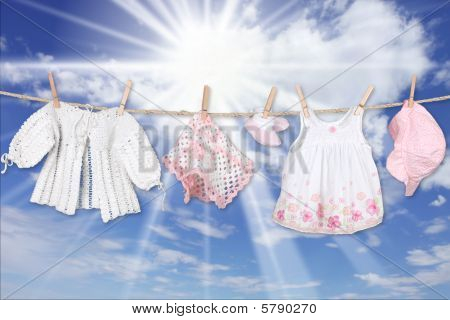 Baby Girl Clothing Hanging On A Clothesline Outdoors