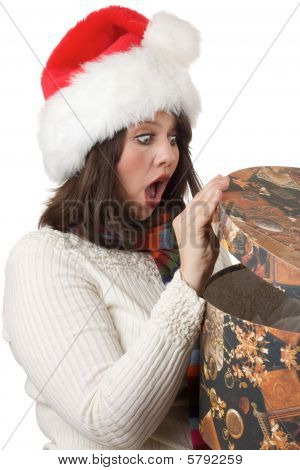 Young woman thrilled with Christmas present; isolated on white