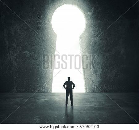 Businessman  Looking Through Key Hole