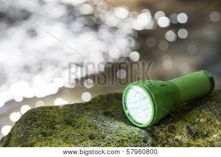 LED flashlight at waterside