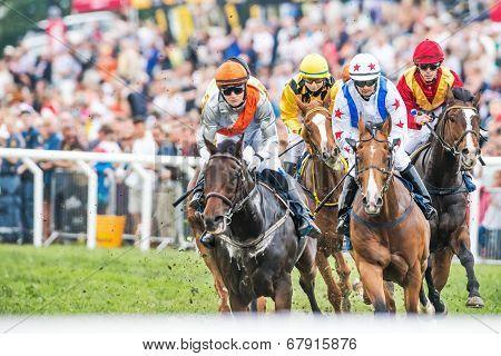 Jockeys Into Last Curve At The Nationaldags Galoppen In Gardet