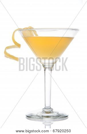 Yellow Banana Cocktail In Martini Glass With Lemon Twist