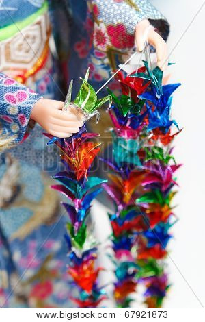 Making Senbazuru (a Thousand Origami Cranes)