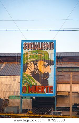 Old Factory In Havana With The Image Of Fidel Castro