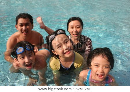 Happy Family In The Pool