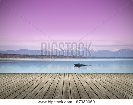 An image of a wooden jetty at the lake Starnberg in Bavaria Germany