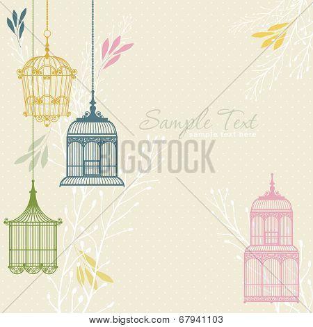 card with vintage birdcage at beige background