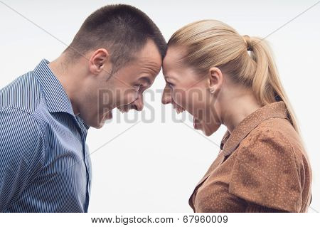 Colleagues fighting each other with foreheads together