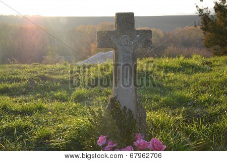 Old grave at sunset in the cemetery, graveyard