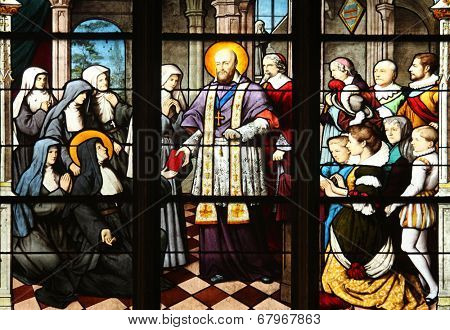 PARIS, FRANCE - NOV 11, 2012: St. Francis de Sales handing St Jeanne de Chantal in the constitutions of the Order of the Visitation. The Church of St Severin is Catholic church in the Latin Quarter.