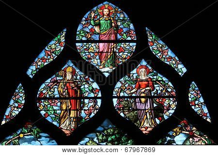 PARIS,FRANCE - NOV 11,2012:Holy bishop (Lazarus?), St. Martha, Christ, stained glass.The Church of St Severin is Catholic church in the Latin Quarter.It is one of the oldest churches on the Left Bank.