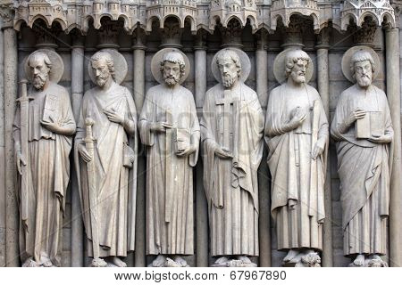 PARIS, FRANCE - NOV 05,2012: Paul, James the Great, Thomas, Philip, Jude, and Matthew, architectural detail of Notre Dame cathedral. Detail of central portal, depicting the Last Judgment (c.1230).