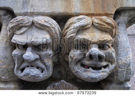 Fresco Of Angry And Happy Male's Face Set In Stone.