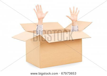 Hands arising from a carton box symbolizing surrender isolated on white background