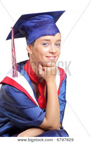 A happy graduating student wearing cap and gown