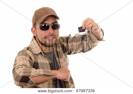 happy young guy in flannel shirt and cap showing car keys
