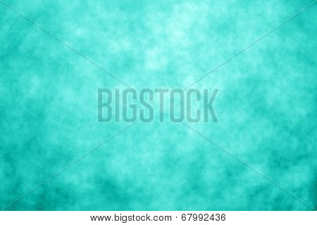 A teal green background and abstract background